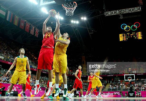 Zhizhi Wang of China shoots against Aleks Maric of Australia in the second half during the Men's Basketball Preliminary Round match on Day 6 of the...