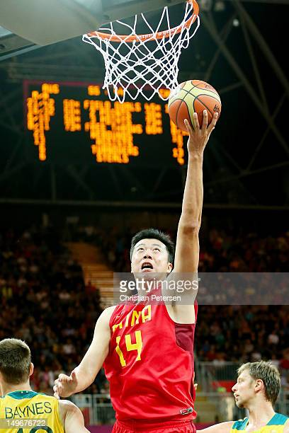 Zhizhi Wang of China shoots against Aron Baynes of Australia in the second half during the Men's Basketball Preliminary Round match on Day 6 of the...