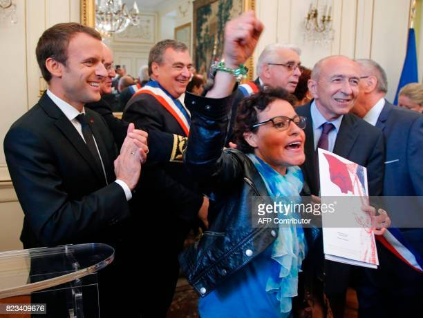 Zhou El Wafi reacts as she becomes a French citizen while French President Emmanuel Macron and French Interior Minister Gerard Collomb stand next to...