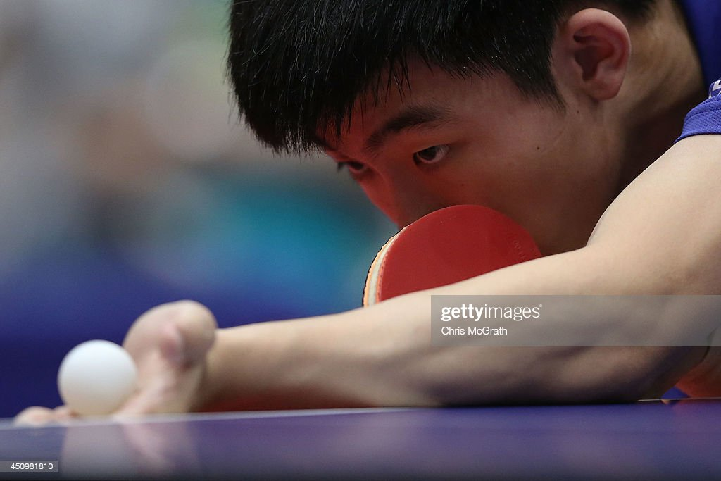 Zhou Kai of China serves against Tang Peng of Hong Kong during their Men's Singles Quarter final match on day two of 2014 ITTF World Tour Japan Open at Yokohama Cultural Gymnasium on June 21, 2014 in Yokohama, Japan.
