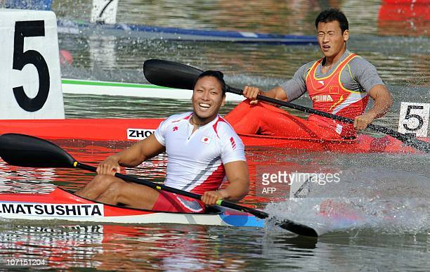 Zhou Peng of China reacts after finishing second behind Momotaro Matsushita of Japan during the men's kayak 2500m final at the 16th Asian Games in...