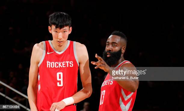 Zhou Qi and James Harden of the Houston Rockets talk during the game against the New York Knicks on October 9 2017 at Madison Square Garden in New...
