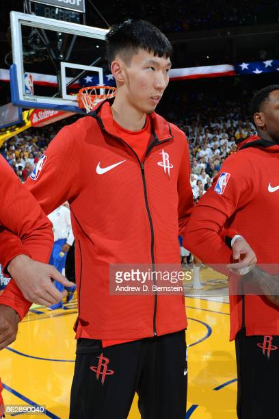 Zhou Qi and the Houston Rockets stands on the court for the National Anthem before the game against the Golden State Warriors on October 17 2017 at...