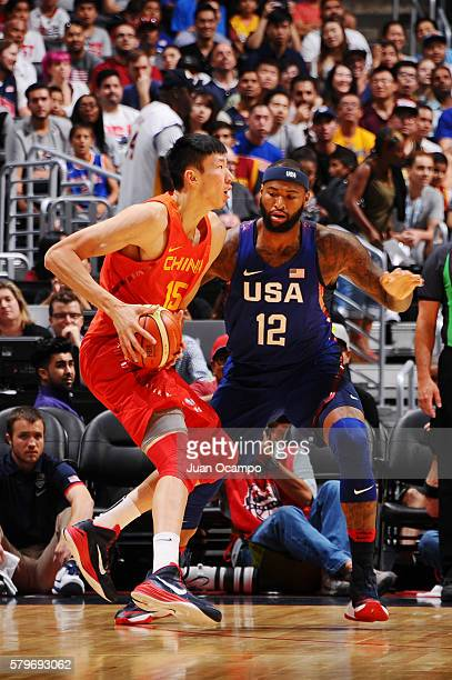Zhou Qi of China handles the ball against DeMarcus Cousins of the USA Basketball Men's National Team on July 24 2016 at STAPLES Center in Los Angeles...