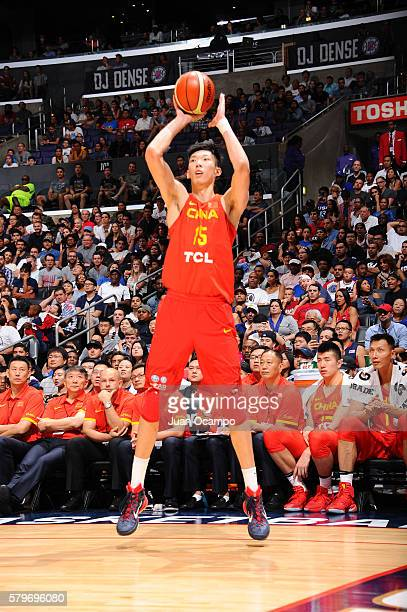 Zhou Qi of China shoots the ball against the USA Basketball Men's National Team on July 24 2016 at STAPLES Center in Los Angeles California NOTE TO...