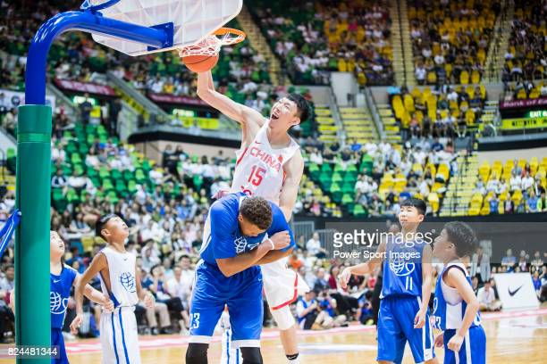 Zhou Qi of Chinese Men's Basketball Stars Team goes up for a dunk against American Professional Nike Rising Star Team during Yao Foundation Charity...