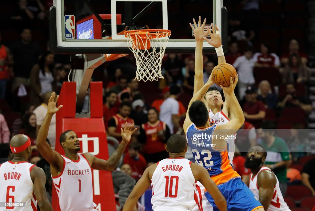 Zhou Qi #9 of Houston Rockets blocks a shot by Zhai Yi #22 of Shanghai Sharks in the second quarter at Toyota Center on October 5, 2017 in Houston, Texas.