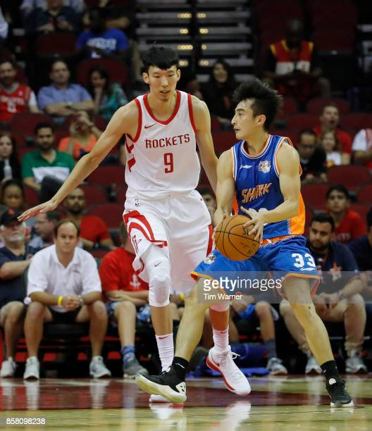 Zhou Qi of Houston Rockets defends Luo Hanchen of Shanghai Sharks in the first half at Toyota Center on October 5 2017 in Houston Texas NOTE TO USER...