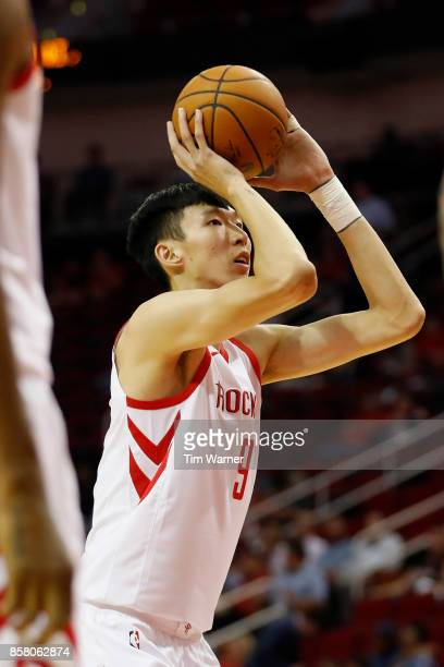 Zhou Qi of Houston Rockets shoots a free throw in the second quarter against the Shanghai Sharks at Toyota Center on October 5 2017 in Houston Texas...