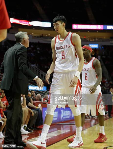 Zhou Qi of Houston Rockets walks to the bench in the fourth quarter against the Shanghai Sharks at Toyota Center on October 5 2017 in Houston Texas...