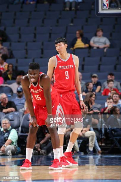 Zhou Qi of the Houston Rockets and Clint Capela of the Houston Rockets look on during a preseason game against the Memphis Grizzlies on October 11...