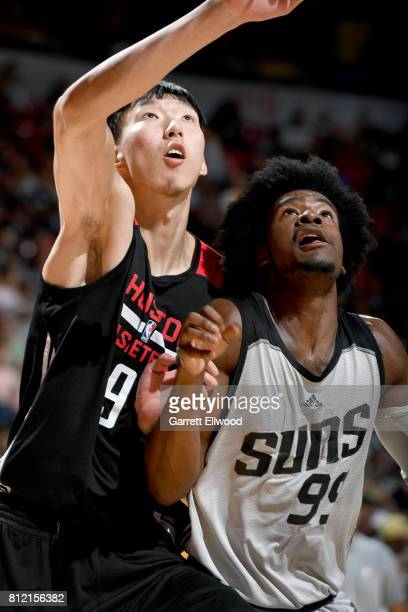Zhou Qi of the Houston Rockets and Josh Jackson of the Phoenix Suns box each other out on July 10 2017 at the Thomas Mack Center in Las Vegas Nevada...