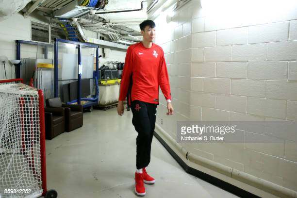 Zhou Qi of the Houston Rockets arrives before the game against the New York Knicks during the preseason game on October 9 2017 at Madison Square...