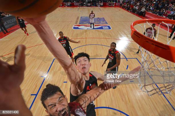 Zhou Qi of the Houston Rockets blocks the ball against Anthony Gill of the Cleveland Cavaliers during the 2017 Las Vegas Summer League on July 8 2017...