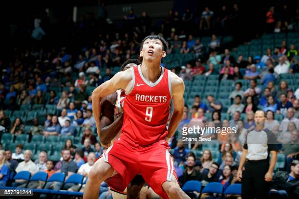 Zhou Qi of the Houston Rockets boxes out the Oklahoma City Thunder during the preseason game on October 3 2017 at the BOK Center in Tulsa Oklahoma...