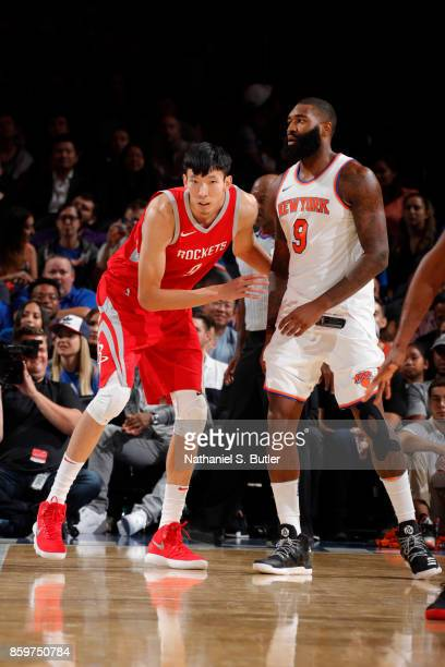 Zhou Qi of the Houston Rockets defends against the New York Knicks during the preseason game on October 9 2017 at Madison Square Garden in New York...