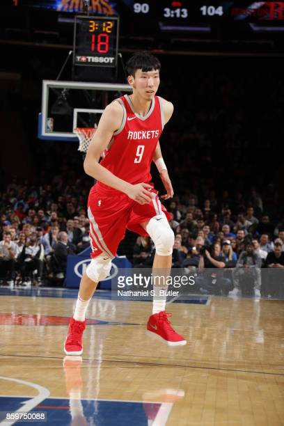 Zhou Qi of the Houston Rockets drives to the basket against the Houston Rockets during the preseason game on October 9 2017 at Madison Square Garden...