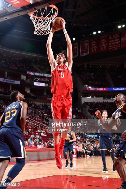 Zhou Qi of the Houston Rockets dunks against the Utah Jazz on November 5 2017 at the Toyota Center in Houston Texas NOTE TO USER User expressly...