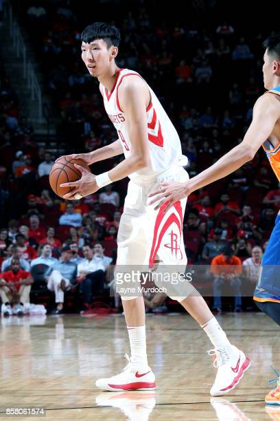 Zhou Qi of the Houston Rockets handles the ball during the preseason game against the Shanghai Sharks on October 5 2017 at the Toyota Center in...