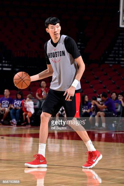 Zhou Qi of the Houston Rockets handles the ball during the team's annual Fan Fest event on October 7 2017 at the Toyota Center in Houston Texas NOTE...