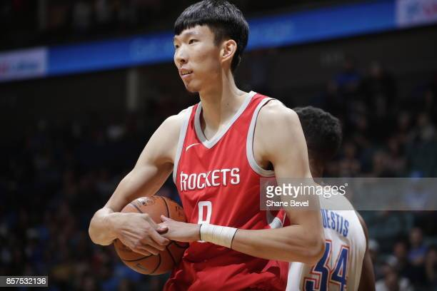 Zhou Qi of the Houston Rockets looks on against the Oklahoma City Thunder during the preseason game on October 3 2017 at the BOK Center in Tulsa...