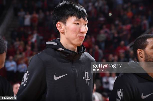 Zhou Qi of the Houston Rockets looks on during the national anthem before the game against the Brooklyn Nets on November 27 2017 at the Toyota Center...