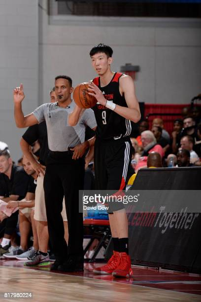 Zhou Qi of the Houston Rockets looks to pass in a game against the Denver Nuggets during the 2017 Las Vegas Summer League on July 7 2017 at the Cox...