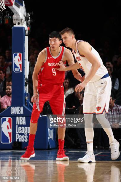 Zhou Qi of the Houston Rockets plays defense against Kristaps Porzingis of the New York Knicks during the game against the New York Knicks on...