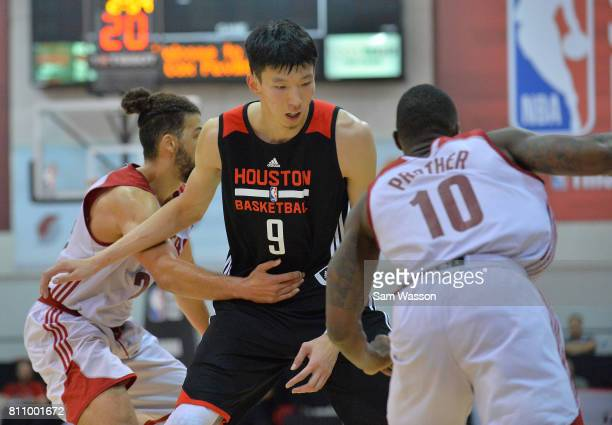 Zhou Qi of the Houston Rockets sets a screen against Casey Prather of the Cleveland Cavaliers during the 2017 Summer League at the Cox Pavilion on...