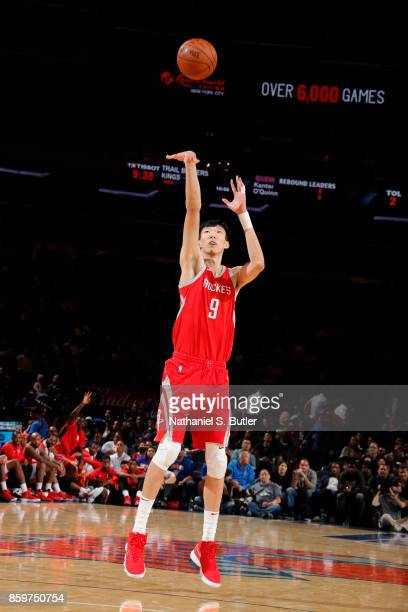 Zhou Qi of the Houston Rockets shoots th ball against the New York Knicks during the preseason game on October 9 2017 at Madison Square Garden in New...
