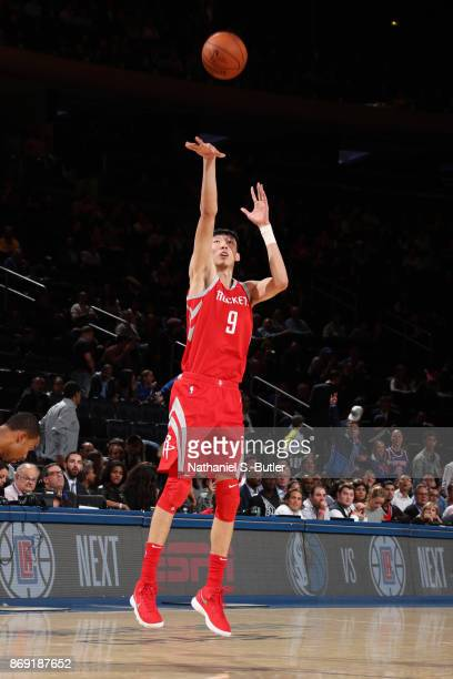 Zhou Qi of the Houston Rockets shoots the ball against the New York Knicks on November 1 2017 at Madison Square Garden in New York City New York NOTE...