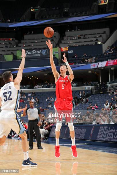 Zhou Qi of the Houston Rockets shoots the ball during a preseason game against the Memphis Grizzlies on October 11 2017 at FedExForum in Memphis...