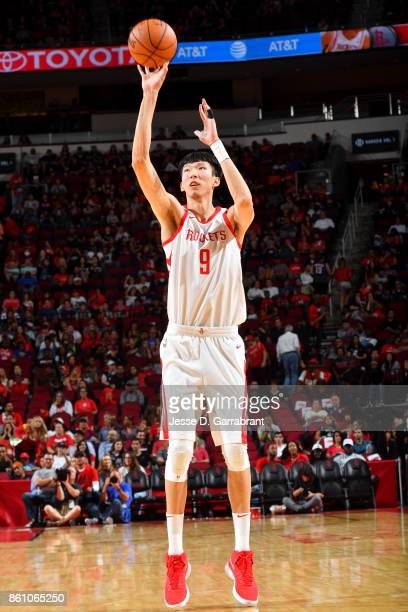 Zhou Qi of the Houston Rockets shoots the ball during the preseason game against the San Antonio Spurs on October 13 2017 at Toyota Center in Houston...
