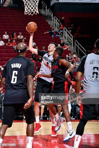 Zhou Qi of the Houston Rockets shoots the ball during the team's annual Fan Fest event on October 7 2017 at the Toyota Center in Houston Texas NOTE...