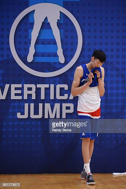 Zhou Qi wipes the sweat from his face between attempts of the Vertical Jump test during 2016 NBA Draft Combine on May 12 2016 at the Quest Multisport...