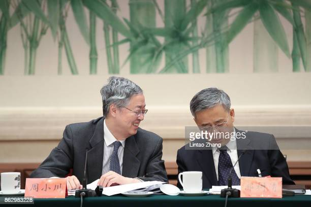 Zhou Xiaochuan governor of the PBOC talk with Guo Shuqing chairman of the China Banking Regulatory Commission attend a news conference at the Great...
