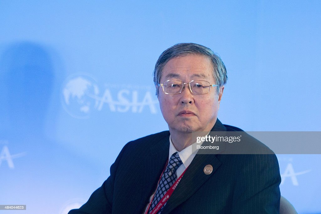 Zhou Xiaochuan, governor of the People's Bank of China (PBOC), attends a session at the Boao Forum for Asia in Boao, Hainan, China, on Friday, April 11, 2014. The Boao Forum for Asia takes place from April 8-11. Photographer: Brent Lewin/Bloomberg via Getty Images