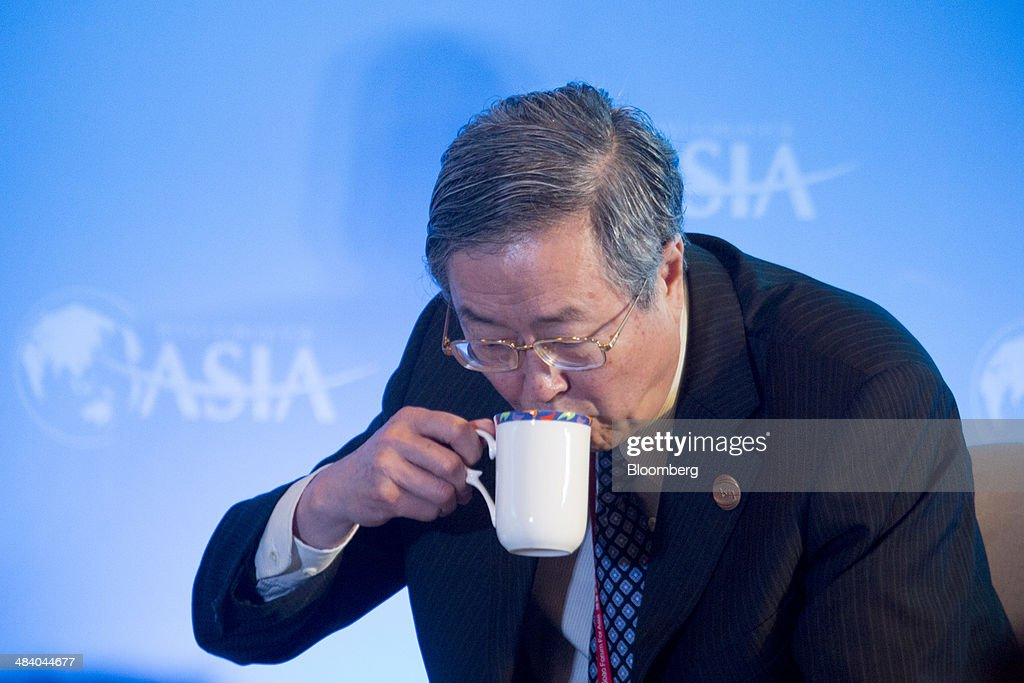 Zhou Xiaochuan, governor of the People's Bank of China (PBOC), drinks from a cup during a session at the Boao Forum for Asia in Boao, Hainan, China, on Friday, April 11, 2014. The Boao Forum for Asia takes place from April 8-11. Photographer: Brent Lewin/Bloomberg via Getty Images