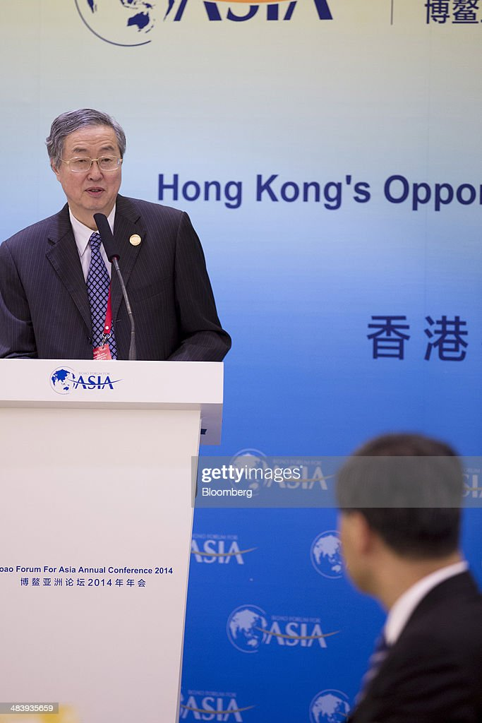 Zhou Xiaochuan, governor of the People's Bank of China (PBOC), left, speaks as Leung Chun-ying, Hong Kong's chief executive, listens during a session at the Boao Forum for Asia in Boao, Hainan, China, on Thursday, April 10, 2014. The Boao Forum for Asia takes place from April 8-11. Photographer: Brent Lewin/Bloomberg via Getty Images