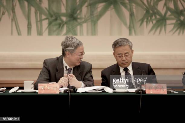 Zhou Xiaochuan governor of the People's Bank of China left speaks with Guo Shuqing chairman of the China Banking Regulatory Commission during a news...