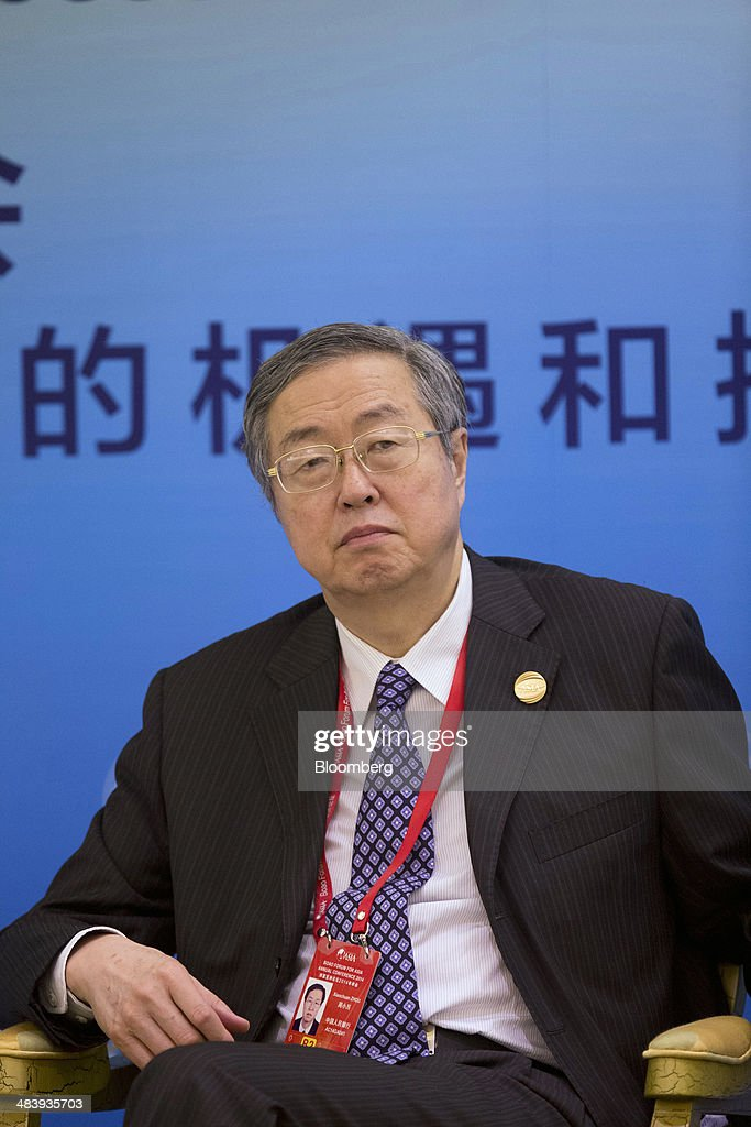 Zhou Xiaochuan, governor of the People's Bank of China (PBOC), listens during a session at the Boao Forum for Asia in Boao, Hainan, China, on Thursday, April 10, 2014. The Boao Forum for Asia takes place from April 8-11. Photographer: Brent Lewin/Bloomberg via Getty Images