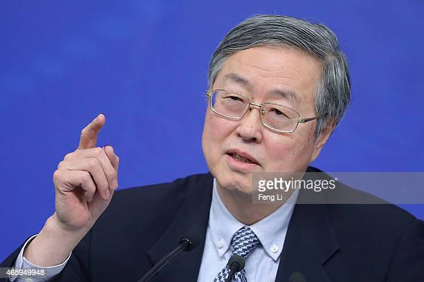 Zhou Xiaochuan governor of the People's Bank of China speaks during a press conference held for the National People's Congress at the media center on...