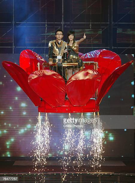 Zhou Xiaoxiao and Xiao Nan who respectively won the female and male champion celebrate after final of the 'Absolutely Singing Loud' a popular TV...