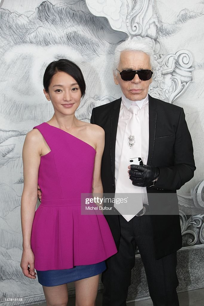 <a gi-track='captionPersonalityLinkClicked' href=/galleries/search?phrase=Zhou+Xun&family=editorial&specificpeople=620373 ng-click='$event.stopPropagation()'>Zhou Xun</a> and Karl Lagerfeld attend the Chanel Haute-Couture Show as part of Paris Fashion Week Fall / Winter 2013 at Grand Palais on July 3, 2012 in Paris, France.