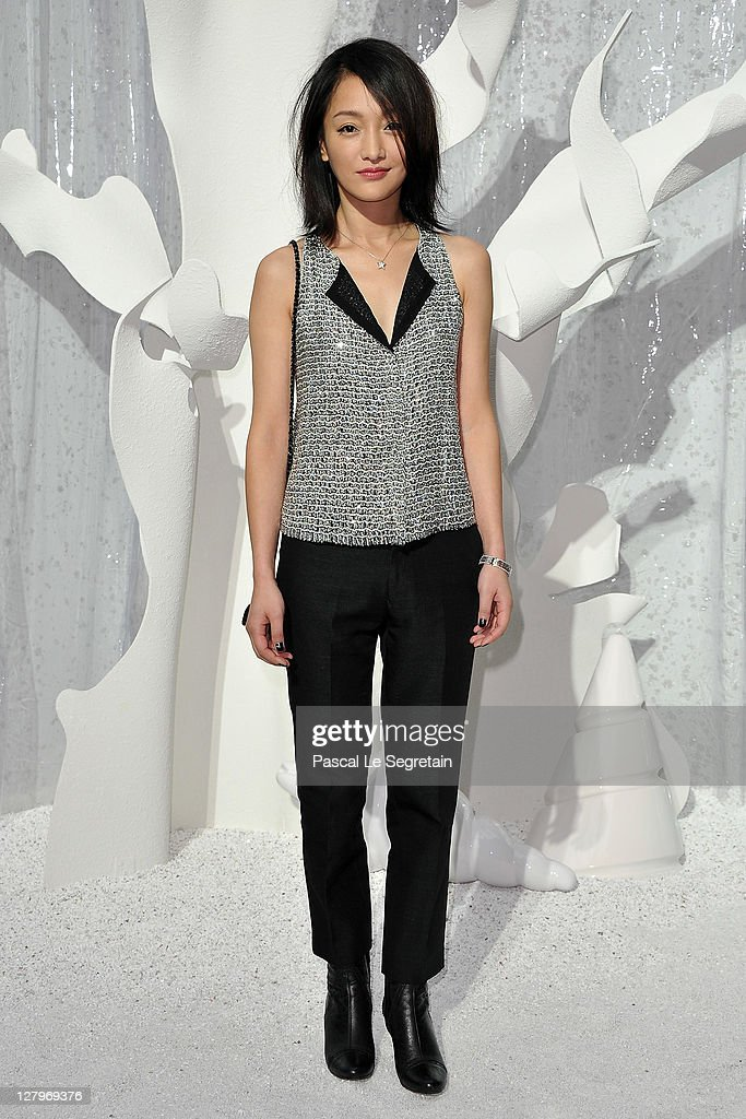 Zhou Xun attends the Chanel Ready to Wear Spring / Summer 2012 show during Paris Fashion Week at Grand Palais on October 4, 2011 in Paris, France.