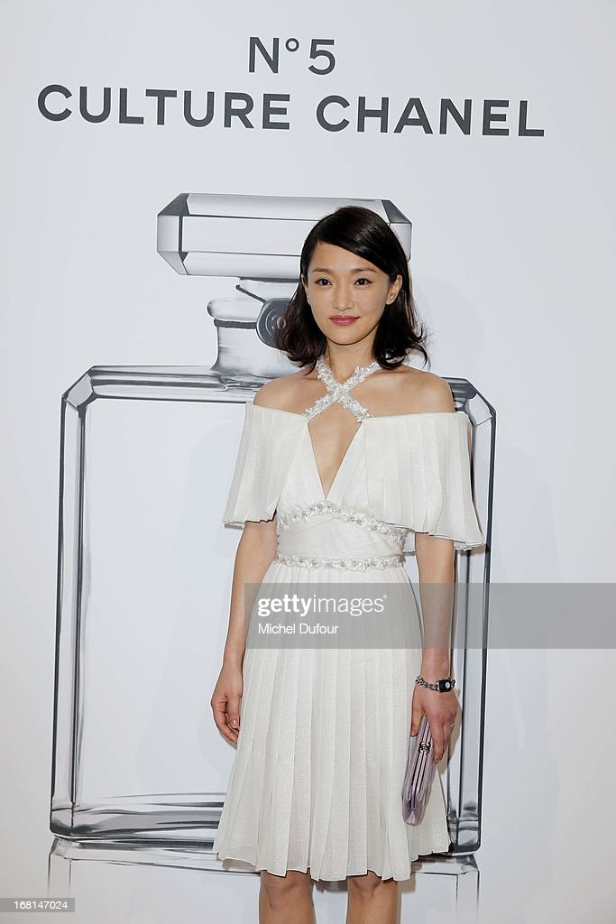 Zhou Xun attends the 'No5 Culture Chanel' Exhibition - Photocall at Palais De Tokyo on May 3, 2013 in Paris, France.