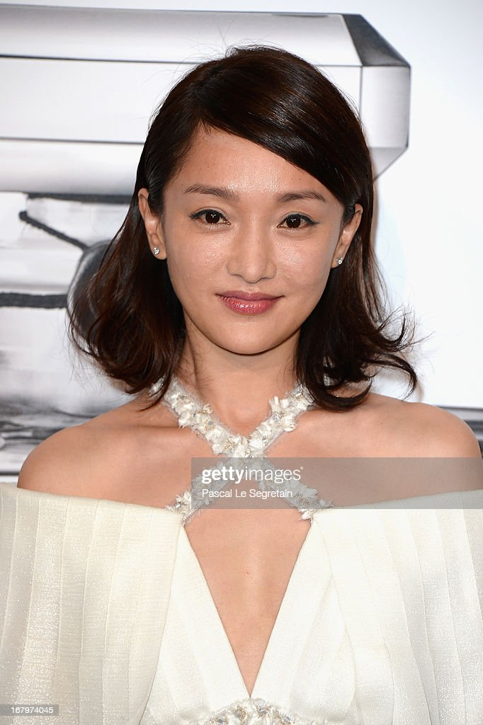 Zhou Xun poses during a photocall for 'N°5 Culture Chanel' exhibition at Palais De Tokyo on May 3, 2013 in Paris, France.