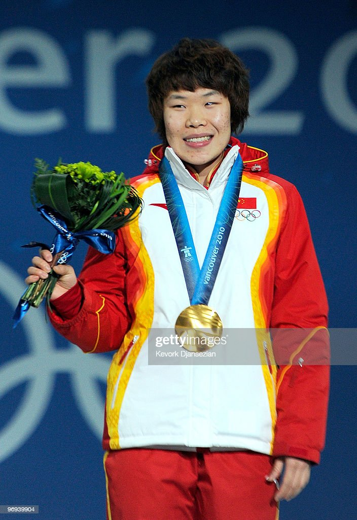 <a gi-track='captionPersonalityLinkClicked' href=/galleries/search?phrase=Zhou+Yang&family=editorial&specificpeople=2199417 ng-click='$event.stopPropagation()'>Zhou Yang</a> of China celebrates her Gold medal during the medal ceremony for the Ladies� 1500m Short Track Speed Skating.