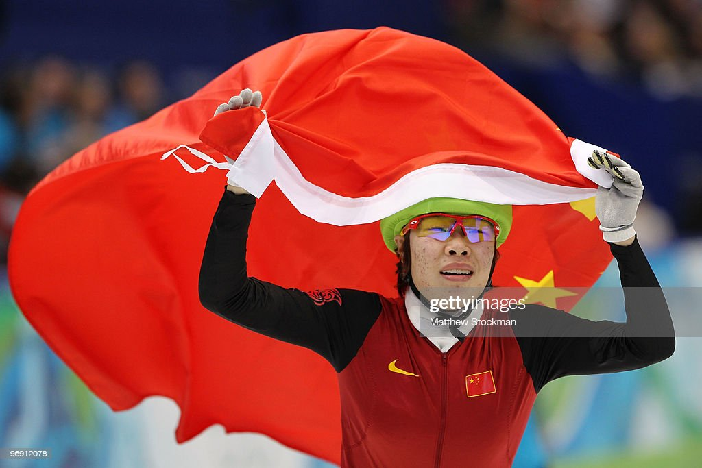 <a gi-track='captionPersonalityLinkClicked' href=/galleries/search?phrase=Zhou+Yang&family=editorial&specificpeople=2199417 ng-click='$event.stopPropagation()'>Zhou Yang</a> of China celebrates winning the goal medal during the Short Track Speed Skating Ladies' 1500 m on day 9 of the Vancouver 2010 Winter Olympics at Pacific Coliseum on February 20, 2010 in Vancouver, Canada.