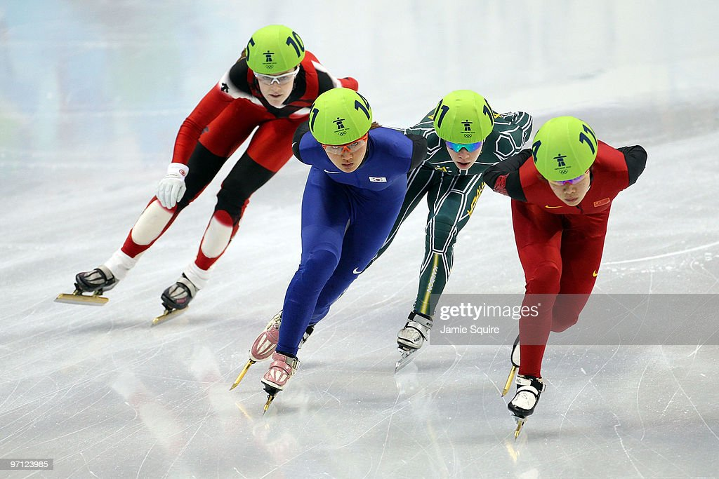Zhou Yang of China leads from Park SeungHi of South Korea Tatiana Borodulina of Australia and Jessica Gregg of Canada in the Ladies' 1000m Short...